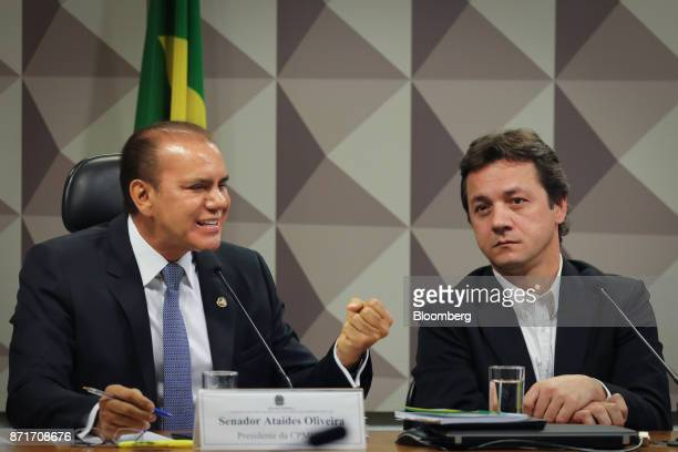 Senator Ataides Oliveira left speaks while Wesley Batista former chief executive officer of JBS SA listens during a congressional inquiry hearing at...