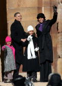 Senator Barack Obama his daughters Sasha and Malia and his wife Michelle wave to a crowd gathered on the lawn of the old State Capital Building...