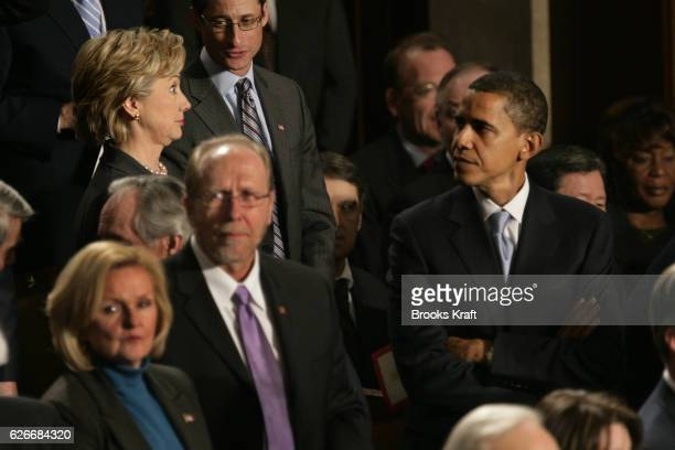 Senator Barack Obama looks at Senator Hillary Rodham Clinton before the State of the Union speech by US President George W Bush on Capitol Hill in...