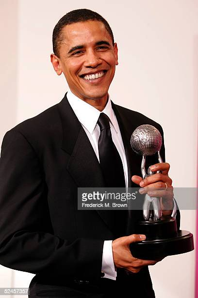 Senator Barack Obama poses in the press room with his award at the 36th NAACP Image Awards at the Dorothy Chandler Pavilion on March 19 2005 in Los...