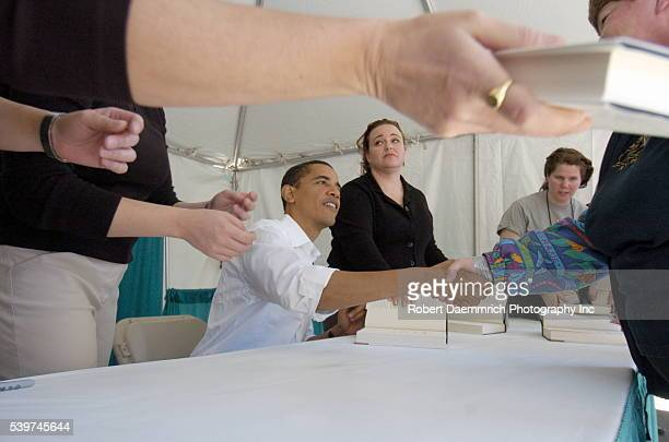 Senator Barack Obama signs books after speaking at the 11th annual Texas Book Festival at the State Capitol