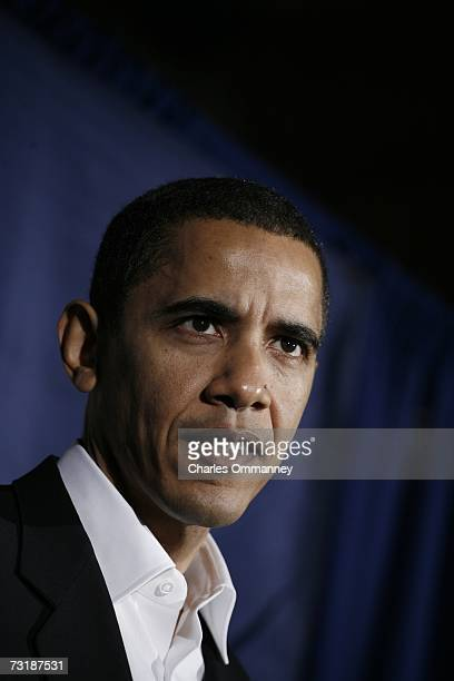 Senator Barack Obama speaks during a press conference 10 December 2006 in Manchester New Hampshire just before a rally by Democrats to celebrate the...
