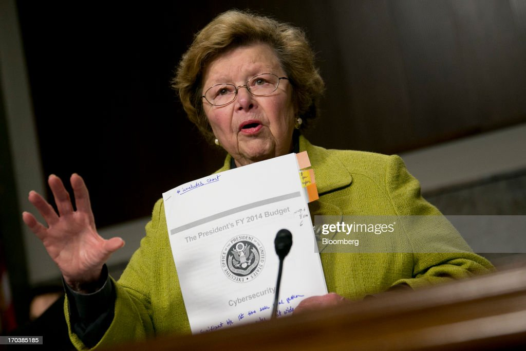 Senator <a gi-track='captionPersonalityLinkClicked' href=/galleries/search?phrase=Barbara+Mikulski&family=editorial&specificpeople=226768 ng-click='$event.stopPropagation()'>Barbara Mikulski</a>, a Democrat from Maryland and chairwoman of the Senate Appropriations Committee, holds up a copy of President Obama's 2014 cybersecurity budget during a hearing with General Keith Alexander, director of the National Security Agency and commander of the U.S. Cyber Command, not pictured, in Washington, D.C., U.S., on Wednesday, June 12, 2013. Americans need to trust the government isn't violating their civil rights after a 29-year-old contractor exposed classified programs to collect broad Internet and telephone-call data, the National Security Agency's director said. Photographer: Andrew Harrer/Bloomberg via Getty Images