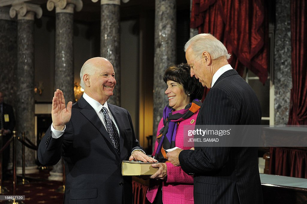 US Senator Ben Cardin, D-MD, (L) participates in a reenacted swearing-in with US Vice President Joe Biden in the Old Senate Chamber at the U.S. Capitol January 3, 2013 in Washington, DC. The 113th US Congress, featuring dozens of new faces in the House and Senate, convened Thursday fresh from the year-end 'fiscal cliff' fiasco, as lawmakers cast a wary eye towards the tough budget battles ahead. AFP PHOTO/Jewel Samad
