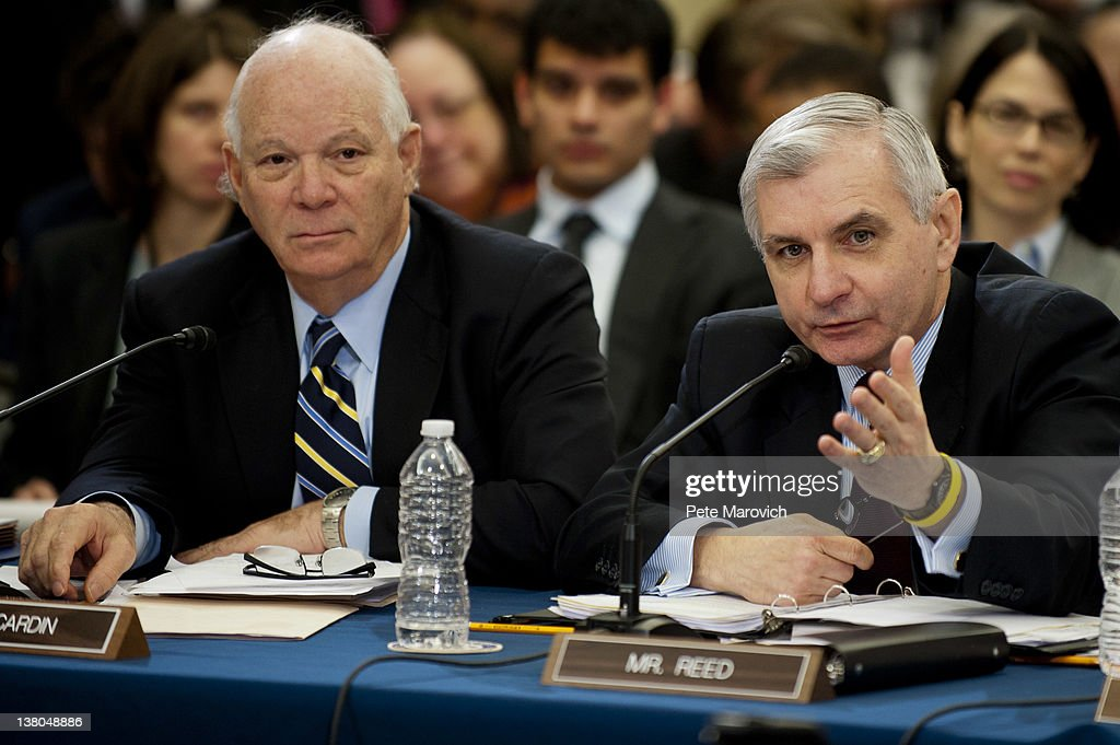 Senator Ben Cardin (D-MD) looks on a U.S. Sen. <a gi-track='captionPersonalityLinkClicked' href=/galleries/search?phrase=Jack+Reed+-+Politician&family=editorial&specificpeople=534274 ng-click='$event.stopPropagation()'>Jack Reed</a> (D-RI) makes his point during a committee meeting to discuss the Temporary Payroll Tax Cut Continuation Act on Capitol Hill February 1, 2012 in Washington, DC. The payroll tax cut legislation, which is set to expire this month, is the conduit for a provision that will allow public transit riders to put away more pre-tax money for commuting costs.