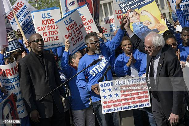Senator Bernard Sanders leaves after speaking as protesters gather to rally for an increase in pay to $15 USD per hour as part of a 'Fight for $15'...
