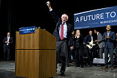 Senator Bernie Sanders an independent from Vermont and 2016 Democratic presidential candidate gestures after speaking during a campaign concert and...