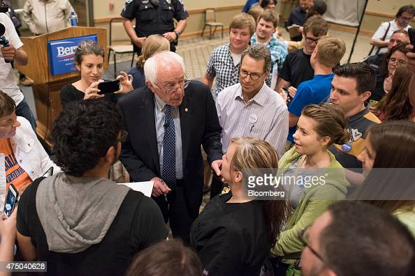 Senator Bernie Sanders an Independent from Vermont and 2016 US presidential candidate center greets attendees during a town hall meeting in Davenport...