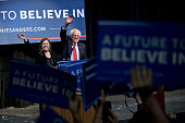 Senator Bernie Sanders an independent from Vermont and 2016 Democratic presidential candidate waves as he arrives to speak with his wife Jane Sanders...