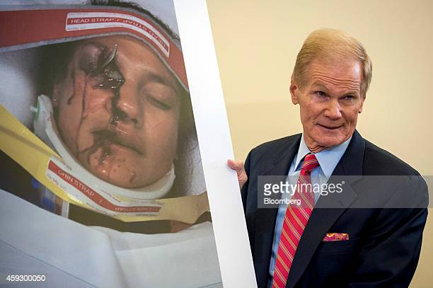 US Senator Bill Nelson a Democrat from Florida shows a photograph of Stephanie Erdman during a Senate Committee on Commerce Science and...