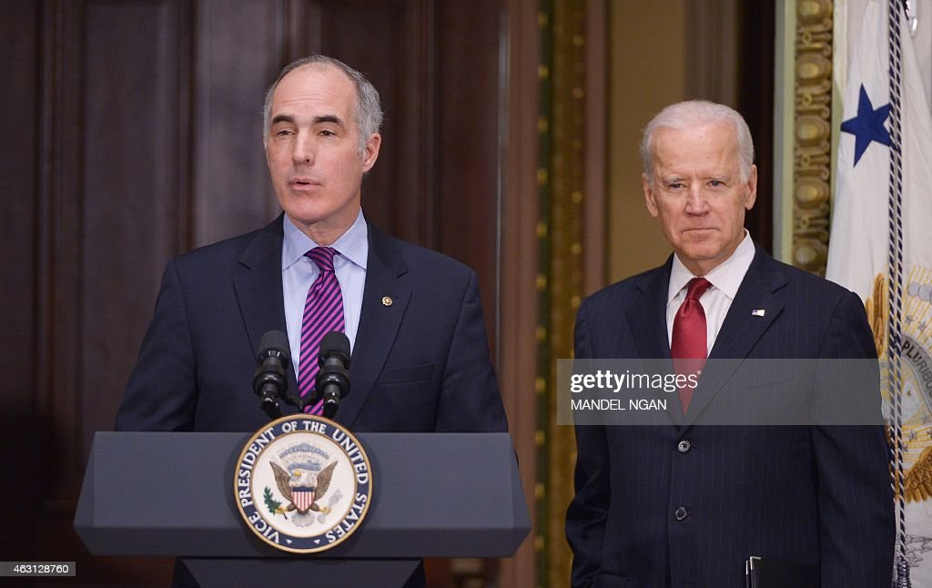 Senator Bob Casey, D-PA, introduces US Vice President Joe Biden during an event with members of Congress to highlight the benefits of the ABLE (Achieving Better Life Expectancy) Act in the Eisenhower Executive Office Building, next to the White House on February 10, 2015 in Washington, DC.