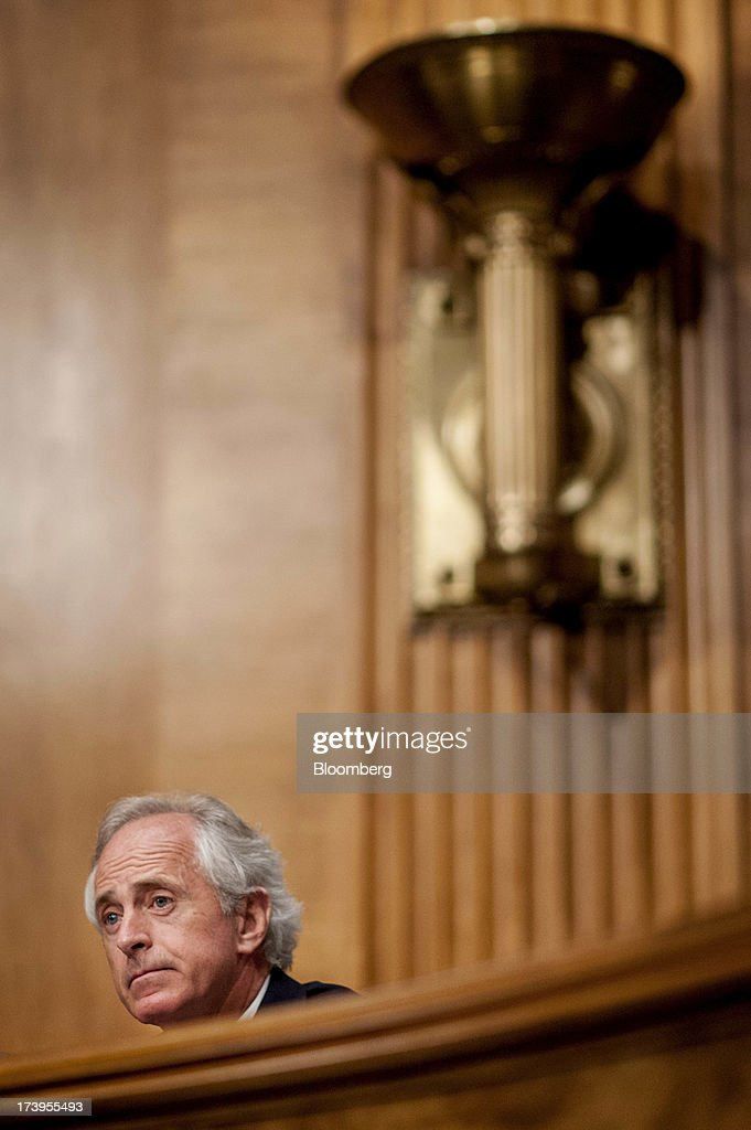Senator <a gi-track='captionPersonalityLinkClicked' href=/galleries/search?phrase=Bob+Corker&family=editorial&specificpeople=3986296 ng-click='$event.stopPropagation()'>Bob Corker</a>, a Republican from Tennessee, listens as Ben S. Bernanke, chairman of the U.S. Federal Reserve, not seen, delivers his semi-annual monetary policy report to the Senate Banking, Housing, and Urban Affairs Committee in Washington, D.C., U.S., on Thursday, July 18, 2013. Bernanke said one reason for the recent rise in long-term interest rates is the unwinding of leveraged and 'excessively risky' investing. Photographer: Pete Marovich/Bloomberg via Getty Images