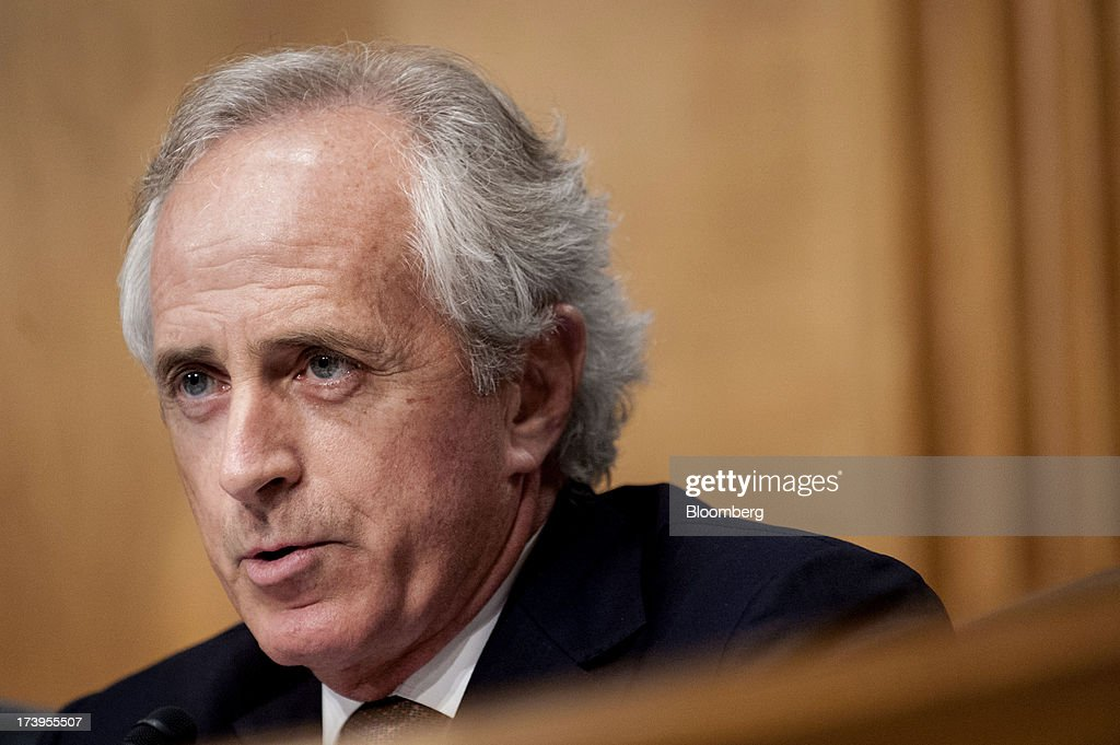 Senator <a gi-track='captionPersonalityLinkClicked' href=/galleries/search?phrase=Bob+Corker&family=editorial&specificpeople=3986296 ng-click='$event.stopPropagation()'>Bob Corker</a>, a Republican from Tennessee, questions Ben S. Bernanke, chairman of the U.S. Federal Reserve, not seen, during his semi-annual monetary policy report to the Senate Banking, Housing, and Urban Affairs Committee in Washington, D.C., U.S., on Thursday, July 18, 2013. Bernanke said one reason for the recent rise in long-term interest rates is the unwinding of leveraged and 'excessively risky' investing. Photographer: Pete Marovich/Bloomberg via Getty Images