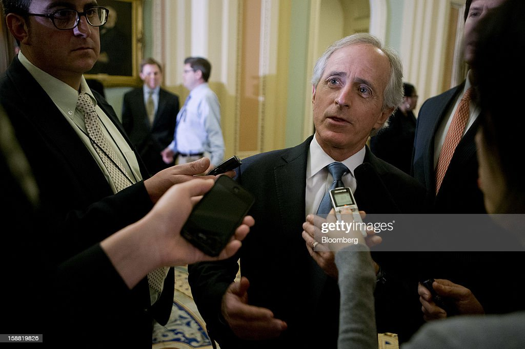 Senator <a gi-track='captionPersonalityLinkClicked' href=/galleries/search?phrase=Bob+Corker&family=editorial&specificpeople=3986296 ng-click='$event.stopPropagation()'>Bob Corker</a>, a Republican from Tennessee, speaks to members of the media at the U.S. Capitol in Washington, D.C., U.S., on Sunday, Dec. 30, 2012. Senate Majority Leader Harry Reid rejected the latest Republican offer to resolve the U.S. fiscal crisis as Minority Leader Mitch McConnell reached out to Vice President Joe Biden in an effort to break the impasse. Photographer: Andrew Harrer/Bloomberg via Getty Images