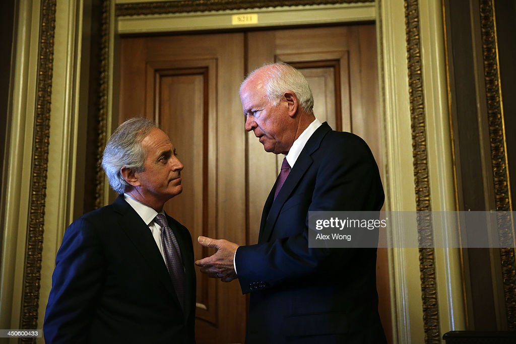 U.S. Senator Bob Corker (R-TN) (L) listens to Senator Saxby Chambliss (R-GA) (R) as they leave after the Senate Republican weekly policy luncheon November 19, 2013 on Capitol Hill in Washington, DC. Senate Republicans participated in the luncheon to discuss Republican agendas.