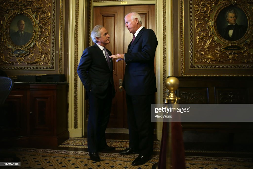 U.S. Senator <a gi-track='captionPersonalityLinkClicked' href=/galleries/search?phrase=Bob+Corker&family=editorial&specificpeople=3986296 ng-click='$event.stopPropagation()'>Bob Corker</a> (R-TN) (L) listens to Senator <a gi-track='captionPersonalityLinkClicked' href=/galleries/search?phrase=Saxby+Chambliss&family=editorial&specificpeople=504972 ng-click='$event.stopPropagation()'>Saxby Chambliss</a> (R-GA) (R) as they leave after the Senate Republican weekly policy luncheon November 19, 2013 on Capitol Hill in Washington, DC. Senate Republicans participated in the luncheon to discuss Republican agendas.
