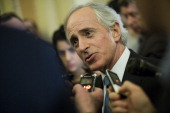 Senator Bob Corker talks with reporters outside of the Senate Chamber on Capitol Hill December 30 2012 in Washington DC The House and Senate are both...