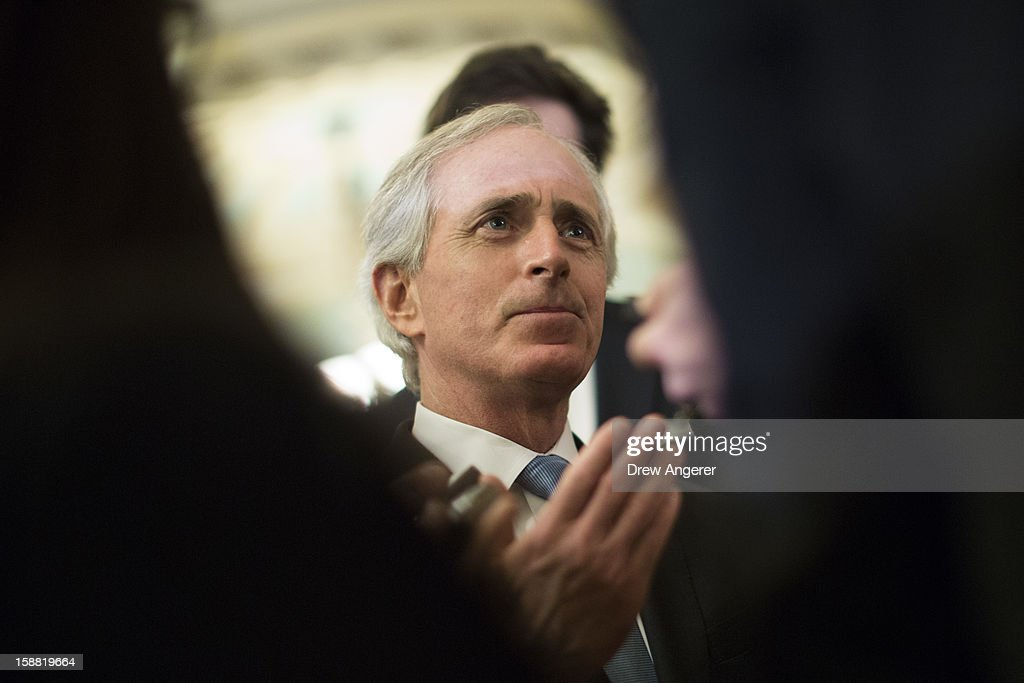 Senator <a gi-track='captionPersonalityLinkClicked' href=/galleries/search?phrase=Bob+Corker&family=editorial&specificpeople=3986296 ng-click='$event.stopPropagation()'>Bob Corker</a> (R-TN) talks with reporters outside of the Senate Chamber on Capitol Hill December 30, 2012 in Washington, DC. The House and Senate are both in session today to deal with the looming 'fiscal cliff.' issue.