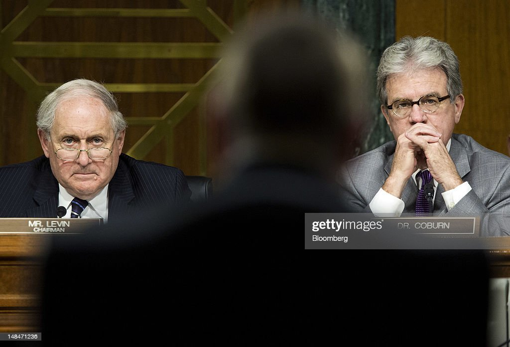 Senator Carl Levin, a Democrat from Michigan, left, and Senator Tom Coburn, a Republican from Oklahoma, right, listen as Irene Dorner, president and chief executive officer of HSBC North America Holdings Inc., testifies at a hearing of the U.S. Senate Homeland Security and Governmental Affairs Committee's Permanent Subcommittee on Investigations in Washington, D.C., U.S., on Tuesday, July 17, 2012. HSBC Holdings Plc's head of group compliance, David Bagley, told the Senate panel he will step down amid charges the bank gave terrorists, drug cartels and criminals access to the U.S. financial system by failing to guard against money laundering. Photographer: Joshua Roberts/Bloomberg via Getty Images *** Carl Levin; Irene Dorner; Tom Coburn