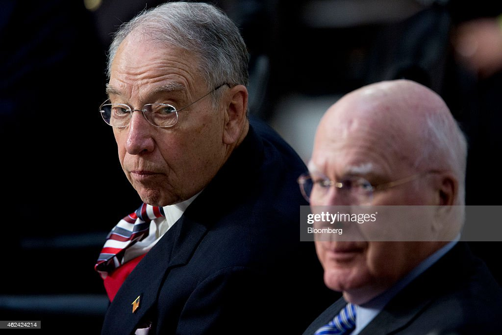 Senator Charles 'Chuck' Grassley, a Republican from Iowa and chairman of the Senate Judiciary Committee, left, and Senator Patrick Leahy, a Democrat from Vermont, listen during a Senate Judiciary Committee nomination hearing for Loretta Lynch, Brooklyn prosecutor and nominee to replace U.S. Attorney General Eric Holder, not pictured, in Washington, D.C., U.S., on Wednesday, Jan. 28, 2015. Lynch said that if confirmed as the next U.S. attorney general she would focus on battling cybercrime and improving relations between police and the communities they serve. Photographer: Andrew Harrer/Bloomberg via Getty Images