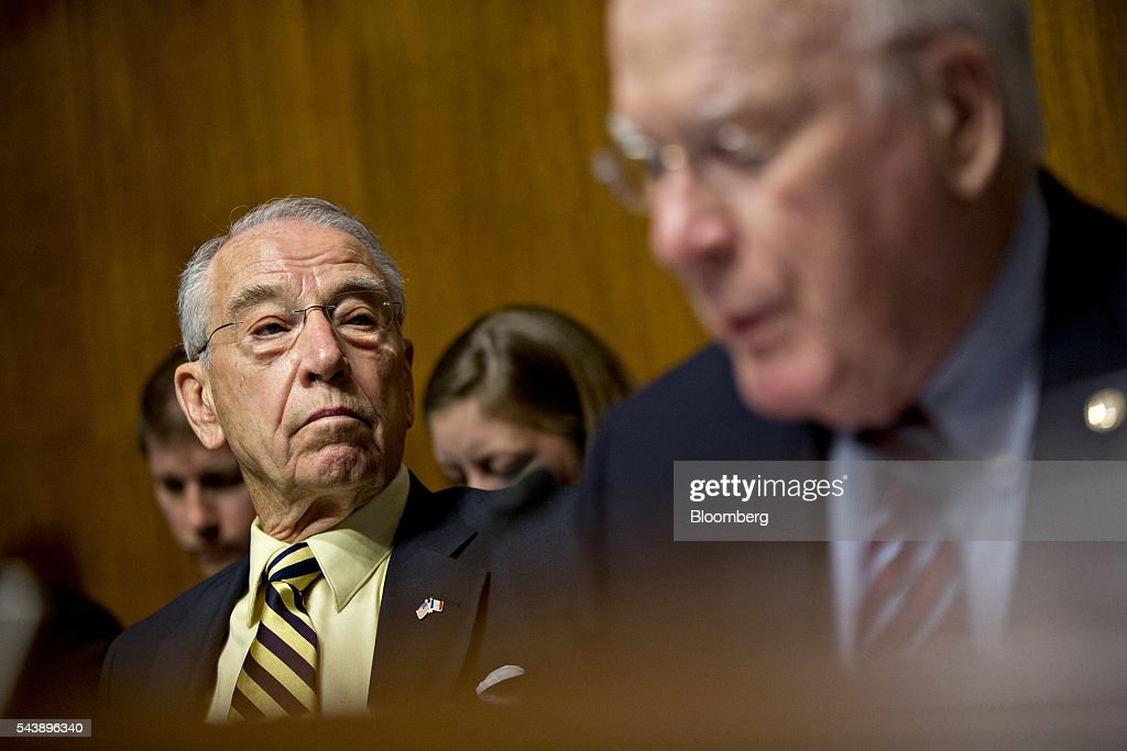 Senator Charles 'Chuck' Grassley, a Republican from Iowa and chairman of the Senate Judiciary Committee, left, listens as ranking member Senator Patrick Leahy, a Democrat from Vermont, speaks during a hearing with Jeh Johnson, U.S. secretary of Homeland Security (DHS), not pictured, in Washington, D.C., U.S., on Thursday, June 30, 2016. Johnson said gun control is a matter of homeland security during the hearing. Photographer: Andrew Harrer/Bloomberg via Getty Images