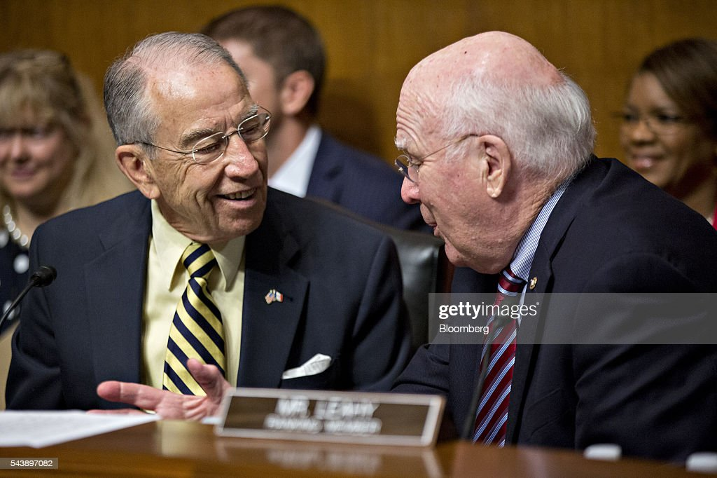 Senator Charles 'Chuck' Grassley, a Republican from Iowa and chairman of the Senate Judiciary Committee, left, talks to ranking member Senator Patrick Leahy, a Democrat from Vermont, during a hearing with Jeh Johnson, U.S. secretary of Homeland Security (DHS), not pictured, in Washington, D.C., U.S., on Thursday, June 30, 2016. Johnson said gun control is a matter of homeland security during the hearing. Photographer: Andrew Harrer/Bloomberg via Getty Images