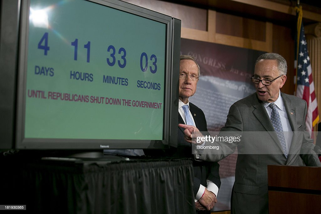 Senator Charles 'Chuck' Schumer, a Democrat from New York, right, speaks during a news conference with Senator <a gi-track='captionPersonalityLinkClicked' href=/galleries/search?phrase=Harry+Reid+-+Politician&family=editorial&specificpeople=203136 ng-click='$event.stopPropagation()'>Harry Reid</a>, a Democrat from Nevada and Senate majority leader, in Washington, D.C., U.S., on Thursday, Sept. 26, 2013. The Senate is accelerating debate on a bill that would avert a U.S. government shutdown as Senate Republicans sought to buy time for their House counterparts to take another swipe at President Barack Obama's health-care law. Photographer: Andrew Harrer/Bloomberg via Getty Images