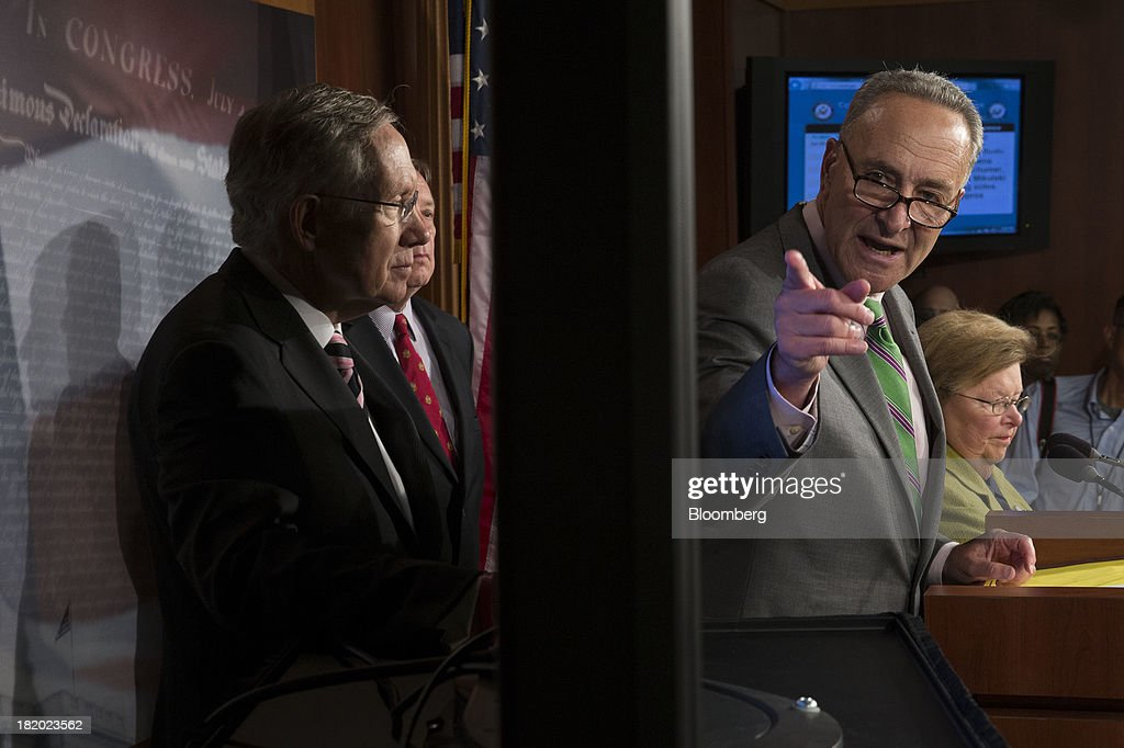Senator Charles 'Chuck' Schumer, a Democrat from New York, right, speaks during a news conference with Senator <a gi-track='captionPersonalityLinkClicked' href=/galleries/search?phrase=Harry+Reid+-+Politician&family=editorial&specificpeople=203136 ng-click='$event.stopPropagation()'>Harry Reid</a>, a Democrat from Nevada and Senate majority leader, following a vote in Washington, D.C., U.S., on Friday, Sept. 27, 2013. The U.S. Senate voted to finance the government through Nov. 15 after removing language to choke off funding for the health care law, putting pressure on the House to avoid a federal shutdown set to start Oct. 1. Photographer: Andrew Harrer/Bloomberg via Getty Images