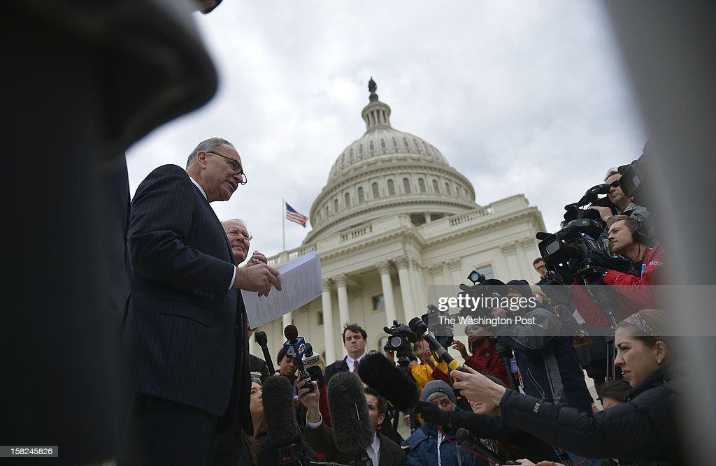 U.S. Senator Charles E. Schumer, left, and U.S. Senator Lamar Alexander, second left, address the media on the progress of inaugural planning outside the U.S. Capitol Building on December 11, 2012 in Washington, D.C.