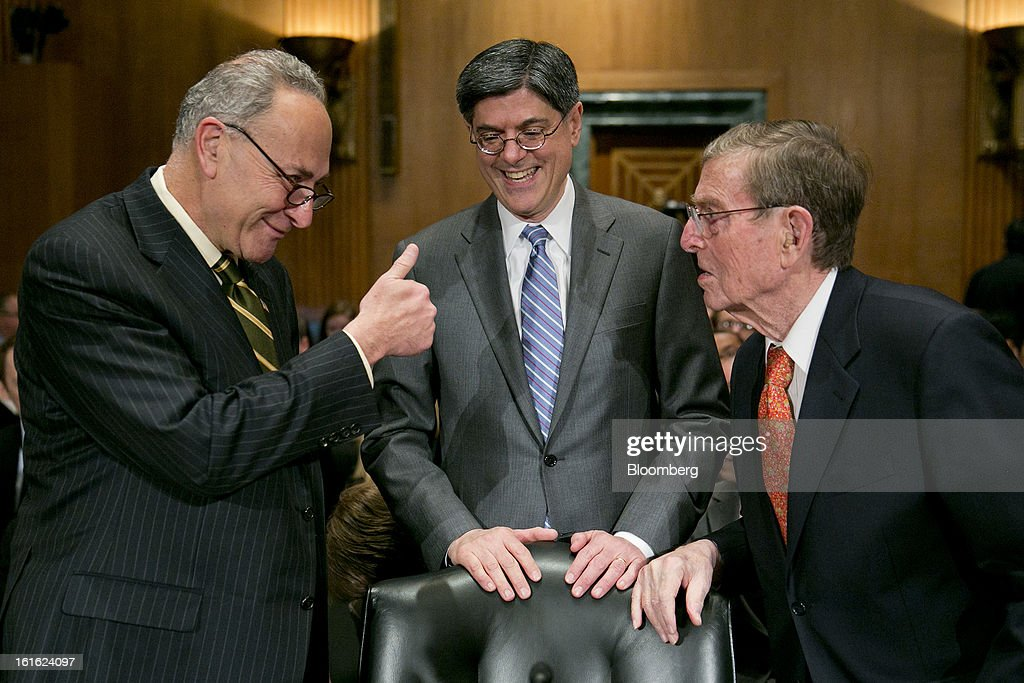 Senator Charles Schumer, a Democrat from New York, left, gives a thumbs up to Pete Domenici, former Republican Senator from New Mexico, right, while Jacob 'Jack' Lew, U.S. treasury secretary nominee and former White House chief of staff, laughs before a Senate Finance Committee hearing in Washington, D.C., U.S., on Wednesday, Feb. 12, 2013. Lew emphasized his ability to work across party lines as he tried to win over Republican senators who were focusing on his work at Citigroup Inc. and an investment in the Cayman Islands. Photographer: Andrew Harrer/Bloomberg via Getty Images