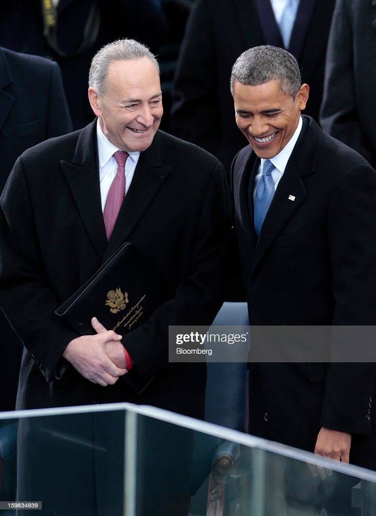Senator Charles Schumer, a Democrat from New York, left, laughs with U.S. President Barack Obama at the Capitol during the U.S. presidential inauguration in Washington, D.C., U.S., on Monday, Jan. 21, 2013. As he enters his second term, President Barack Obama has shed the aura of a hopeful consensus builder determined to break partisan gridlock and adopted a more confrontational stance with Republicans. Photographer: Andrew Harrer/Bloomberg via Getty Images *** Barack Obama; Charles Schumer
