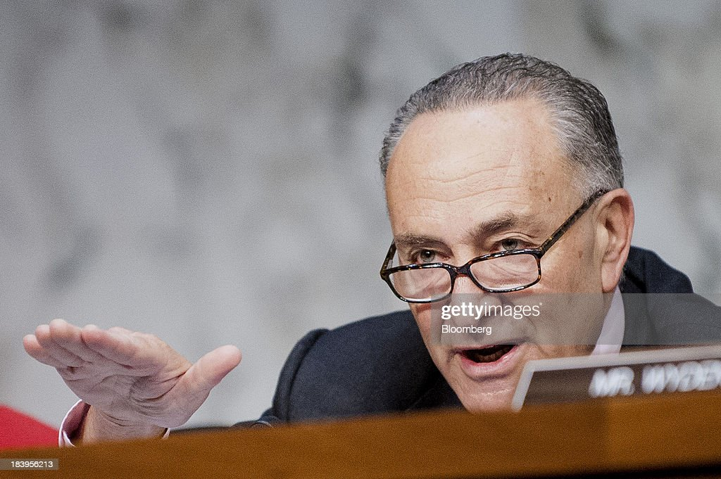 Senator <a gi-track='captionPersonalityLinkClicked' href=/galleries/search?phrase=Charles+Schumer&family=editorial&specificpeople=171249 ng-click='$event.stopPropagation()'>Charles Schumer</a>, a Democrat from New York, speaks during a Senate Finance Committee hearing on Capitol Hill in Washington, D.C., U.S., on Thursday, Oct.10, 2013. Treasury Secretary Jacob Lew warned that the congressional deadlock over the U.S. debt ceiling is 'beginning to stress the financial markets,' and failing to raise it by Oct. 17 could put Social Security and Medicare payments at risk. Photographer: Pete Marovich/Bloomberg via Getty Images