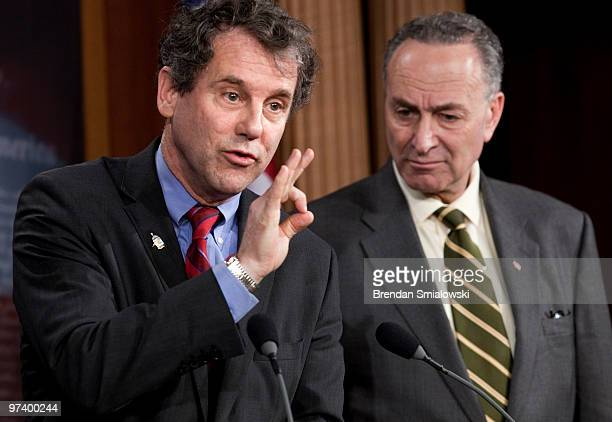 Senator Charles Schumer listens as Sen Sherrod Brown speaks during a news conference on Capitol Hill March 3 2010 in Washington DC Sen Charles...