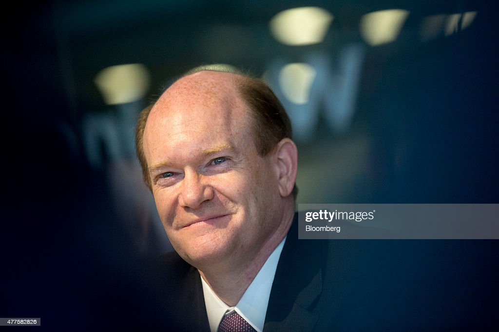 Senator Chris Coon, a Democrat from Delaware, smiles while listening to a question during an interview in Washington, D.C., U.S., on Thursday, June 18, 2015. The House plans to vote Thursday on a bill to revive President Barack Obama's fast-track trade proposal after leaders decided to attach the fast-track proposal, known as trade-promotion authority, to an unrelated bill. Coons said that he doesn't want votes on the worker-assistance program separated from the fast-track measure. Photographer: Andrew Harrer/Bloomberg via Getty Images
