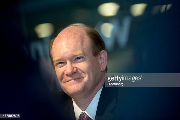 Senator Chris Coon a Democrat from Delaware smiles while listening to a question during an interview in Washington DC US on Thursday June 18 2015 The...