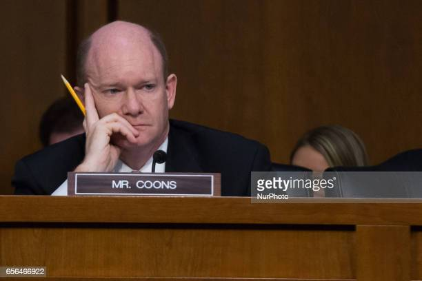 US Senator Chris Coons listens as President Trump's Supreme Court nominee Judge Neil Gorsuch testifies on day two of his confirmation hearings in...