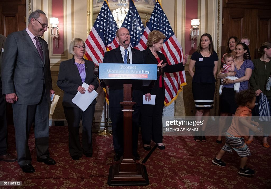 US Senator Chris Coons (D-DE) speaks as Senators Charles Schumer (L)D-NY, Patty Murray (2nd L) D-WA and Debbie Stabenow (CenterR)D-MI hold a press conference with health experts, and local mothers to demand that Congress pass emergency funding to combat the spread of the Zika virus in the US on Capitol Hill in Washington, DC, on May 25, 2016. / AFP / Nicholas Kamm