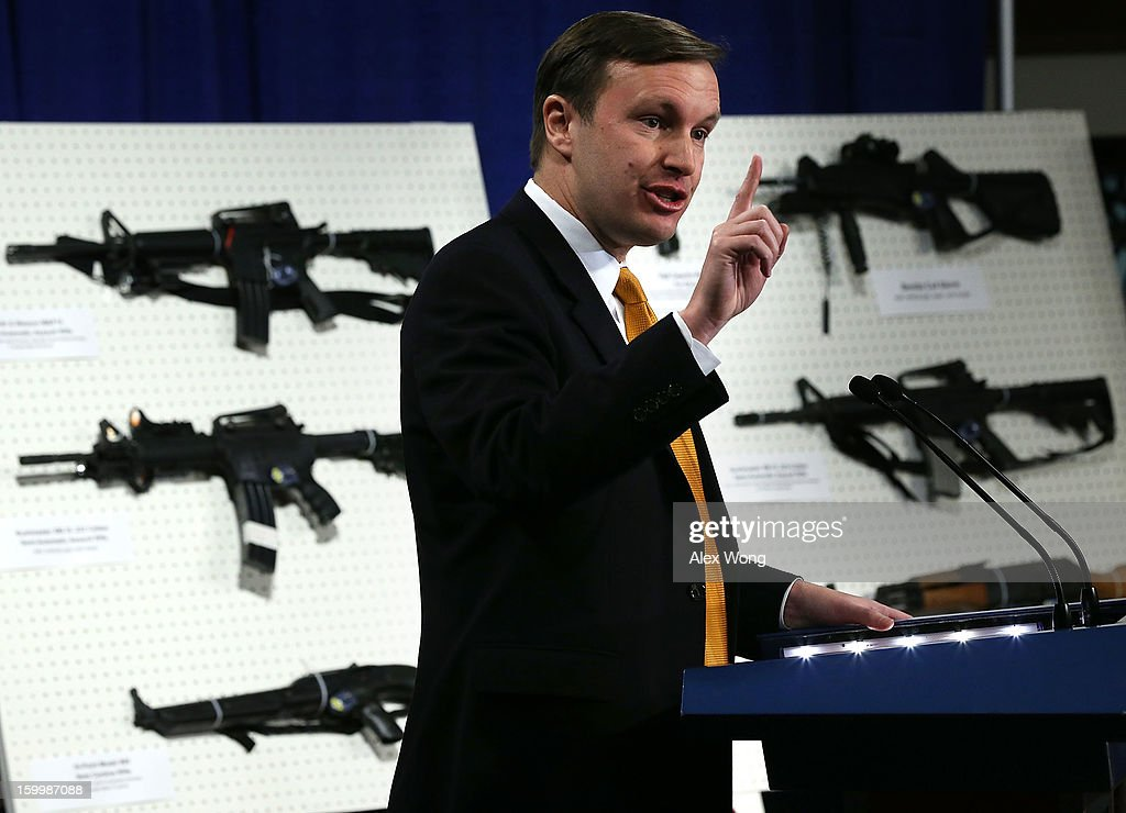 U.S. Senator Chris Murphy (D-CT) speaks next to a display of assault weapons during a news conference January 24, 2013 on Capitol Hill in Washington, DC. U.S. Senator Dianne Feinstein (D-CA) announced that she will introduce a bill to ban assault weapons and high-capacity magazines capable of holding more than 10 rounds to help to stop gun violence.