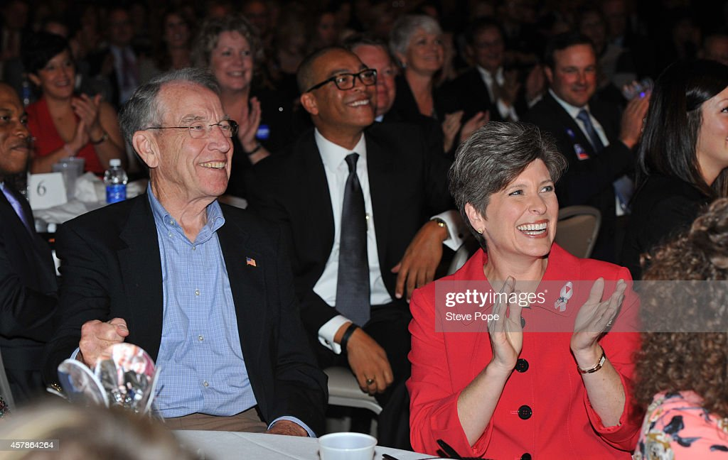 U.S. Senator Chuck Grassley (R-IA) shares a laugh with Republican Candidate from Iowa for U.S. Senate Joni Ernst, at a Birthday Bash for Gov. Terry Branstad (R-IA) October 25, 2014 in Clive, Iowa. Already distinguished as the states longest -serving governor, Branstad would become the longest -serving governor in U.S. history, were he to win the November 4th election.