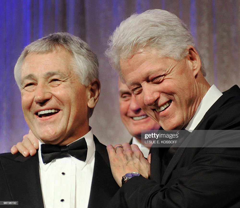 Senator Chuck Hagel (L) enjoys a laugh with former US president <a gi-track='captionPersonalityLinkClicked' href=/galleries/search?phrase=Bill+Clinton&family=editorial&specificpeople=67203 ng-click='$event.stopPropagation()'>Bill Clinton</a> (R) as Hagel presents Clinton with the Atlantic Council's Distinguished International Leadership Award on April 28, 2010, in Washington, DC. The Atlantic Council is a non-partisan group with a mission of promoting international cooperation, particularly between the US and Europe. AFP PHOTO / Leslie E. Kossoff