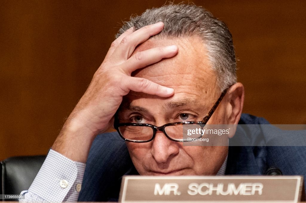 Senator Chuck Schumer, a Democrat from New York, listens as Ben S. Bernanke, chairman of the U.S. Federal Reserve, not seen, delivers his semi-annual monetary policy report to the Senate Banking, Housing, and Urban Affairs Committee in Washington, D.C., U.S., on Thursday, July 18, 2013. Bernanke said one reason for the recent rise in long-term interest rates is the unwinding of leveraged and 'excessively risky' investing. Photographer: Pete Marovich/Bloomberg via Getty Images