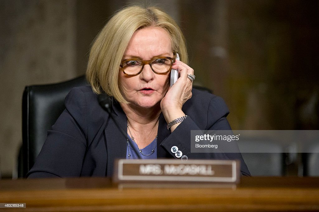 Senator Claire McCaskill a Democrat from Missouri talks on a mobile phone before a Senate Armed Services Committee hearing with Army General John...