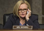 US Senator Claire McCaskill Democrat of Missouri speaks on a cellplhone prior to a hearing on the situation in Afghanistan by the Senate Armed...