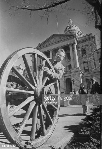 Senator Concerned About State of the Cannon Sen Hugh Fowler RLittleton inspects the wheel of an antique cannon in front of the Capitol Fowler noted...
