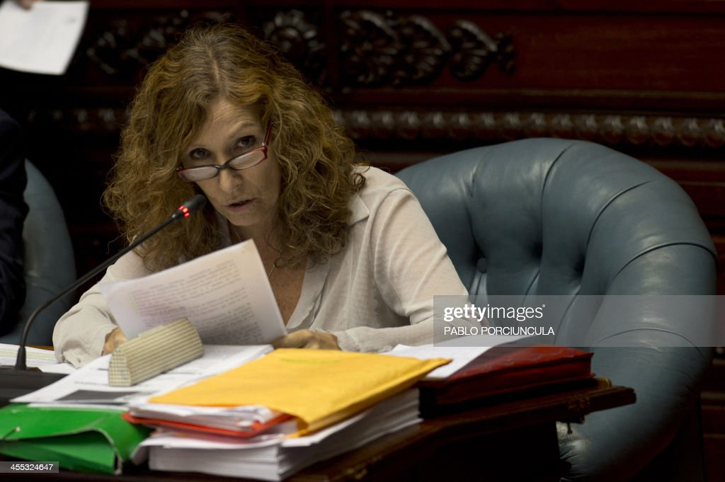 Senator Constanza Moreira of the ruling Frente Amplio (Broad Front) takes part in the parliament discussion of a law on the legalization of marijuana's cultivation and consumption on December 10, 2013, in Montevideo. Uruguays parliament is to vote Tuesday a project that would make the country the first to legalize marijuana, an experiment that seeks to confront drug trafficking. The initiative launched by 78-year-old Uruguayan President Jose Mujica, a former revolutionary leader, would enable the production, distribution and sale of cannabis, self-cultivation and consumer clubs, all under state control. AFP PHOTO/ Pablo PORCIUNCULA