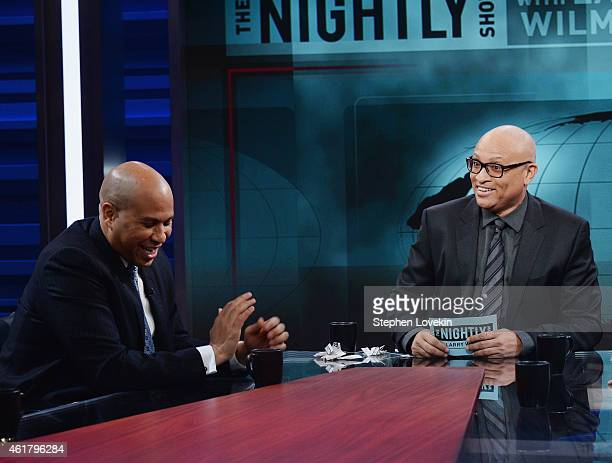 Senator Cory Booker and host Larry Wilmore appear on the debut episode of Comedy Central's 'The Nightly Show with Larry Wilmore' at The Nightly Show...