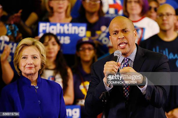 Senator Cory Booker introduces Democratic presidential candidate Hillary Clinton at a campaign rally June 1 in Newark New Jersey / AFP / DOMINICK...