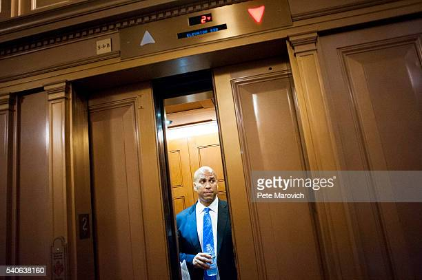 Senator Cory Booker leaves in an elevator after assisting Senator Chris Murphy in waging an almost 15hour filibuster on the Senate floor in order to...