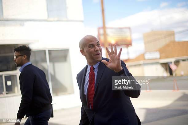 Senator Cory Booker waves to a supporter as he arrives for a Breaking Down Barriers Town Hall for Democratic Presidential candidate former Secretary...