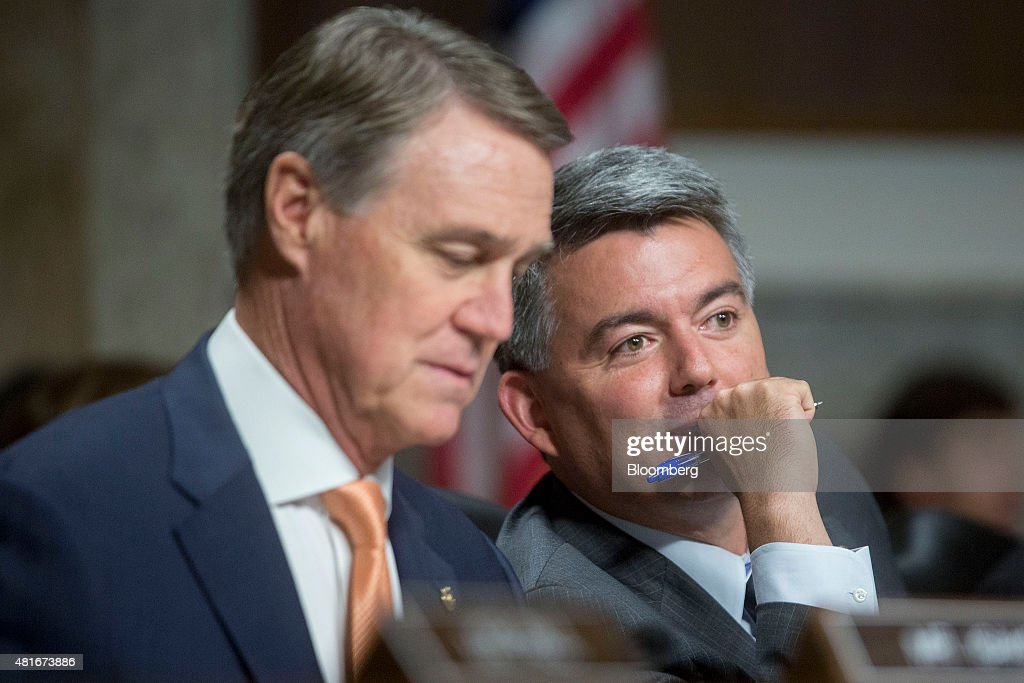 Senator <a gi-track='captionPersonalityLinkClicked' href=/galleries/search?phrase=Cory+Gardner&family=editorial&specificpeople=6977442 ng-click='$event.stopPropagation()'>Cory Gardner</a>, A Republican from Colorado, right, talks to Senator <a gi-track='captionPersonalityLinkClicked' href=/galleries/search?phrase=David+Perdue&family=editorial&specificpeople=4276858 ng-click='$event.stopPropagation()'>David Perdue</a>, a Republican from Georgia, during a Senate Foreign Relations Committee hearing in Washington, D.C., U.S., on Thursday, July 23, 2015. Senator Bob Corker, a key player in the congressional debate over the nuclear deal with Iran, told Secretary of State John Kerry that the Obama administration is engaging in hyperbole to sell it. Photographer: Andrew Harrer/Bloomberg via Getty Images